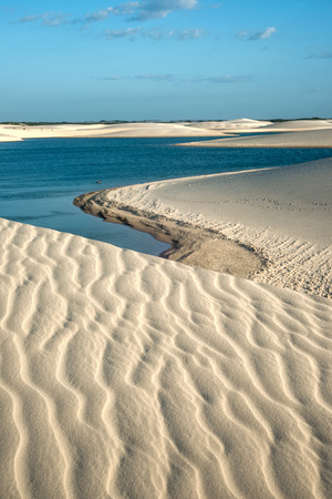 discrete: Lencois Maranhenses National Park, Brazil, low, flat, flooded land, overlaid with large, discrete sand dunes with blue and green lagoons