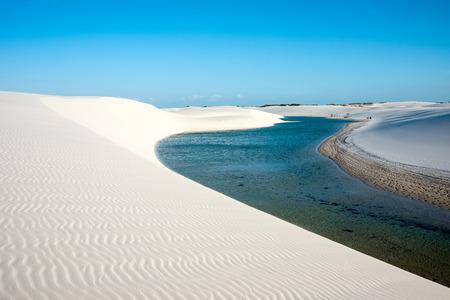 discrete: Lencois Maranhenses National Park, Barreirinhas, Brazil, low, flat, flooded land, overlaid with large, discrete sand dunes with blue and green lagoons
