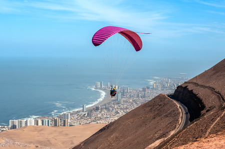 Iquique behind a huge dune, northern Chile, Tarapaca Region, Pacific coast, west of the Atacama Desert and the Pampa del Tamarugal Stock Photo - 66004766