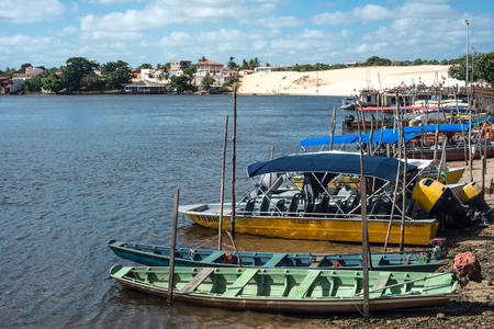Barreirinhas, Brazil - 13 July, 2016: Tourist boats waiting for tourists on the river Rio Preguica, Maranhao, Lencois Maranhenses National Park, northern Brazil