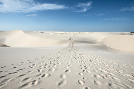 Lencois Maranhenses, Brazil, July 13, 2016 - Tourists are going trouth Sand dunes with blue and green lagoons in Lencois Maranhenses National Park Editorial