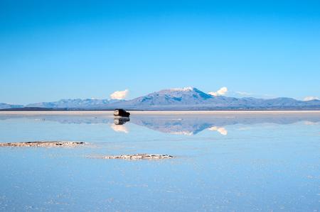 Salt lake - Salar de Uyuni, Bolivia - July 24, 2011: The car crossed the salt lake of Uyuni. Salar de Uyuni is located at an altitude of 4000 meters above sea level on the Altiplano plateau