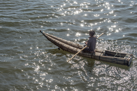 Pimentel, Peru - March 16, 2015: The fisherman goes to sea on a Traditional Peruvian small Reed Boats (Caballitos de Totora), straw boats still used by local peoples in Peru Editorial