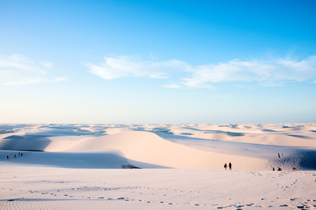 Lencois Maranhenses,Brazil, July 13, 2016 - Tourists are saying goodbye to the sun from Sand dunes with blue and green lagoons in Lencois Maranhenses National Park