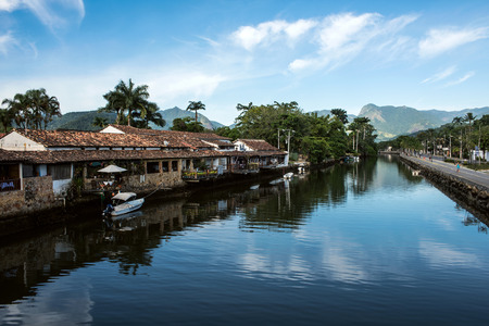 Paraty, Brazil - February 24, 2017: An iconic view of the canal and the colonial houses of the historic town Paraty, Rio de Janeiro state, Brazil