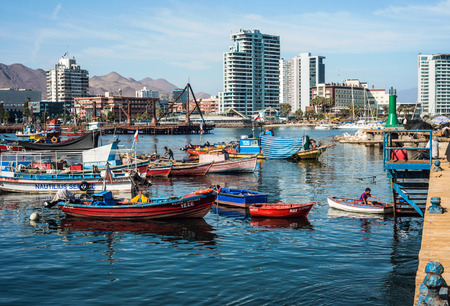 Antofagasta, Chile - April 5, 2015: Colourful wooden fishing boats in the harbour at Antofagasta in the Atacama Region of Chile