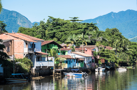 Paraty, Brazil - February 24, 2017: View of the canal and the colonial houses of the historic town Paraty, Rio de Janeiro state, Brazil Editorial