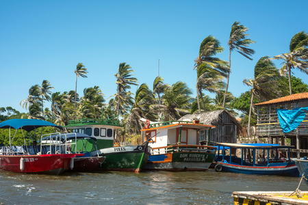 BARREIRINHAS, BRAZIL - 14 JULY 2016: Fishing boats are waiting for a tide near the Cabure lighthouse in Lencois National Park