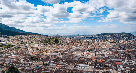 Panoramic photo of Quito capital city at sunset, Ecuador, South America Stock Photo
