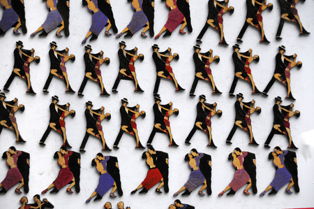 Buenos Aires, Argentina - July 9, 2011: Refrigerator magnets with the image of tango dancers are sold during the tango-feast on the street