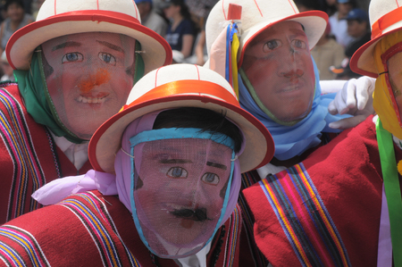 Quito, Ecuador - November 30, 2008: People in traditional Ecuadorean masks dance as part of a parade through the streets celebrates its Spanish Foundation of the city Editorial