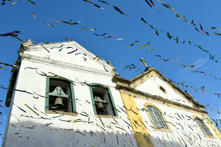 Paraty, Brazil - February 24, 2017: Typical street with colonial buildings in historic town Paraty on the time of Carnival, Brazil