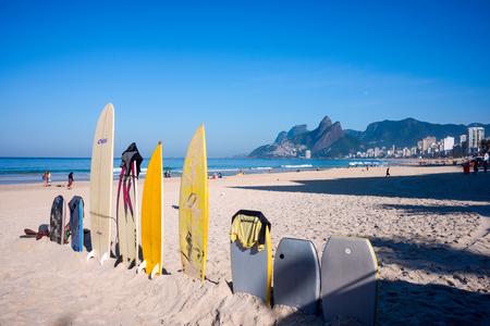Rio de Janeiro, Brazil - July 24, 2016: Surfboards standing upright in bright sun on the Ipanema beach