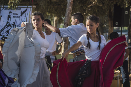 Tacuarembo, Uruguay - March 9, 2018: Gauchos (South American cowboys) dancing at the annual Traditional Gauchos Feast