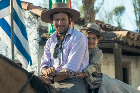 Tacuarembo, Uruguay - March 9, 2018: Gauchos (South American cowboys) poses during the Traditional Gauchos Feast