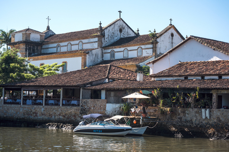Paraty, Brazil - February 28, 2017: An iconic view of the canal and the colonial houses of the historic town Paraty, Rio de Janeiro state, Brazil
