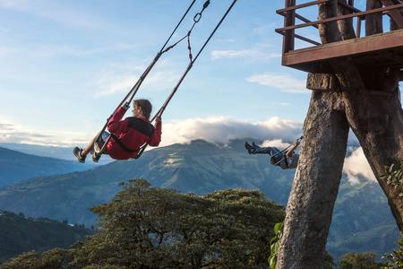 Banos, Ecuador - November 22, 2017: The Swing At The End Of The World Located At Casa Del Arbol, The Tree House In Banos De Aqua Santa, Ecuador, South America Editorial