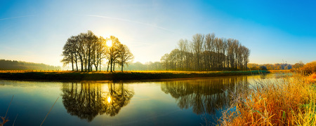 Sunrise at the river Standard-Bild