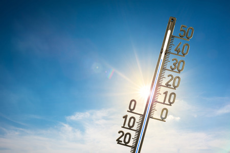 Blue sky with sun and thermometer Stock Photo