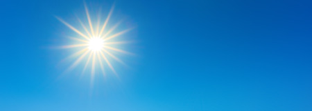 Sunny background, beautiful blue sky with bright sun