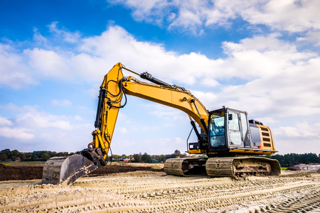 Big excavator in construction site Stock Photo