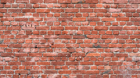 Old red brick wall as background or texture