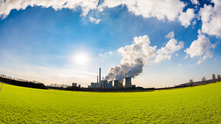 Coal fired power plant with smoking cooling towers