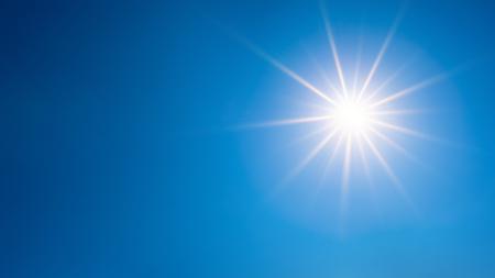 Summer background, wonderful blue sky with bright sun