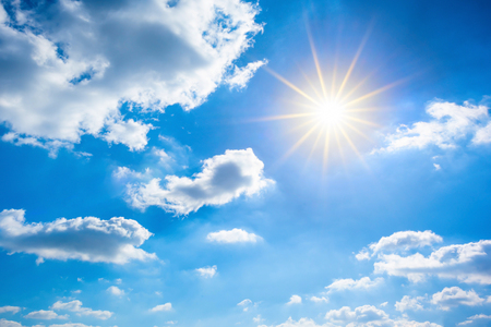 Hot summer or heat wave background, beautiful blue sky with glowing sun and clouds 스톡 콘텐츠