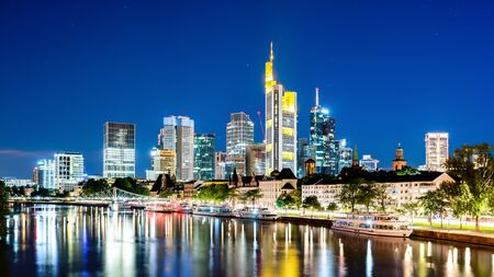 Skyline of Frankfurt with the Main river at night