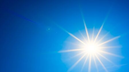Hot summer or heat wave background, beautiful blue sky with glowing sun 스톡 콘텐츠