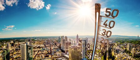 Panorama of Frankfurt on a hot summer day with bright sun and big thermometer