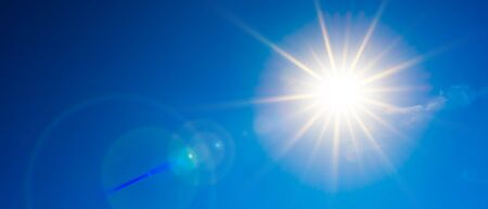 Hot summer or heat wave background, beautiful blue sky with glowing sun Stockfoto