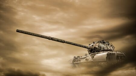 Old battle tank driving through the desert