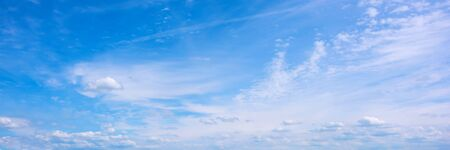Beautiful blue sky with fluffy clouds