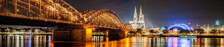 Cologne with Cologne Cathedral and Rhine at night Stock Photo - 137323546