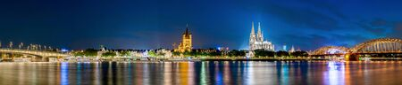 Panorama of Cologne with Cologne Cathedral, Rhine and Hohenzollern Bridge at night