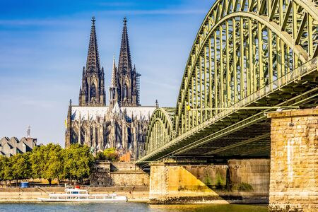 Cologne with the Cologne Cathedral and the Hohenzollern Bridge in the light of the morning sun
