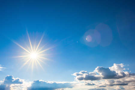 Beautiful blue summer sky with clouds and bright sun 스톡 콘텐츠