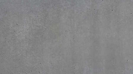 Texture of a dark gray concrete or cement wall