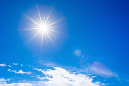 Blue summer sky with bright sun as a background