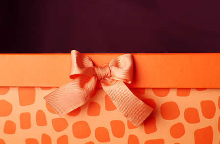 Orange gift box with a bow Stock Photo