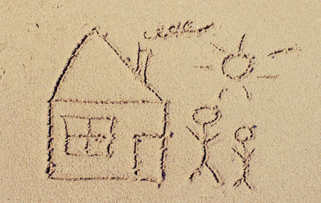 Drawing in the sand on the beach