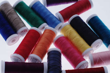 Colorful threads on white background Stock Photo