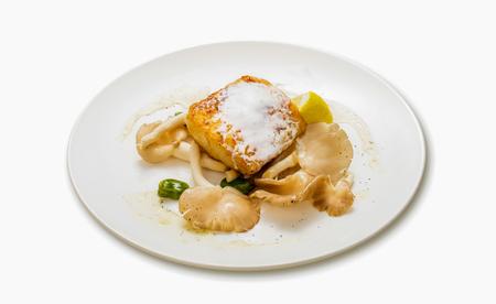 Fried cod fish with yogurt dill sauce Stock Photo
