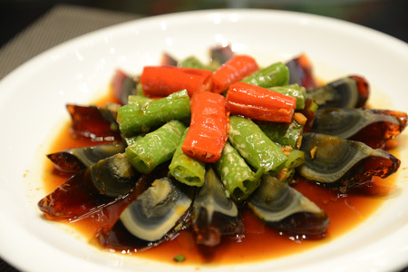 Double peppers and century eggs 版權商用圖片 - 91673776