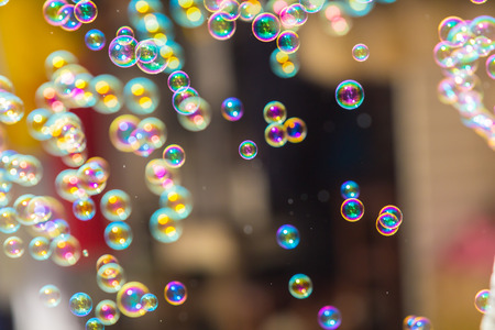 bubble: The rainbow soap bubbles from the bubble blower.