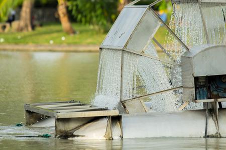 water turbine: Water turbine - Chaipattana in the public park. Stock Photo
