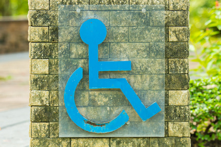 wheelchair access: Disabled permit sign in the garden.