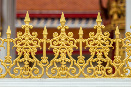 iron fence: Golden or yellow fence of temple. Stock Photo